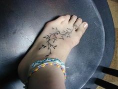 Tender vine design for your foot, if you wish to flaunt a sleek tattoo