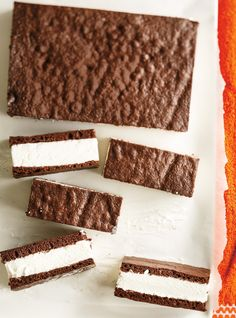The only thing better than a warm, chewy cookie is two cookies — with a big scoop of ice cream sandwiched between them! Cool off this summer with these creative and delicious ice cream sandwich recipes. We guarantee you'll want to try every single one. Easy Ice Cream Sandwich Recipe, Churro Ice Cream Sandwich, Homemade Ice Cream Sandwiches, Ice Cream Recipes, Sandwich Recipes, Icecream Sandwich, Brownie Ice Cream, Chocolate Chip Ice Cream, Ice Cream Cookies