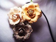 Handmade paper flowers on a headband. :)