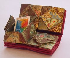 Chinese thread book from Moote Points - not leather but very interesting idea.