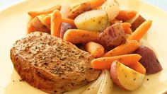 Roast pork chops with vegetables and herbs for a simple and hearty dinner.