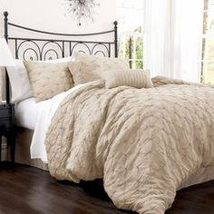 """Offering romantic style for your master suite, this feminine comforter set showcases a lovely embroidered motif in taupe.  Product: Queen: 1 Comforter, 1 bed skirt and 2 standard shamsKing: 1 Comforter, 1 bed skirt and 2 king shamsConstruction Material: Polyester and down fillColor: TaupeFeatures:  Embroidered details14.5"""" Bed skirt dropDimensions: Standard Sham: 20"""" x 26""""Queen Comforter: 96"""" x 92""""King Sham: 20"""" x 36""""King Comforter: 96"""" x 110""""Note: Accents pillows are not included. Shams do…"""