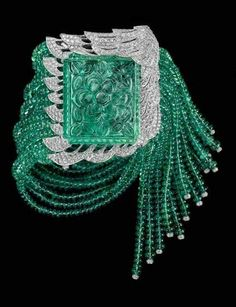 Vintage 1940s Cartier bracelet with 77.3-carat carved emerald, emerald beads and diamonds.