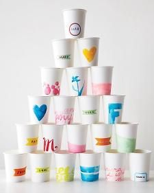 . With water colors which dry quickly., washi tape,  but know water colors won't adhere to wax coated cups. Use plain matte cups like above (think garnish.com)