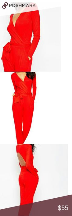 Brand new Asos Red Jumpsuit size 12 Brand new with tag Asos red open back jumpsuit.  Very sexy and Classy, you will get a lot of compliments. It will a 14 as well, beautiful well made material. From pet free and smoke free home. ASOS Curve Pants Jumpsuits & Rompers