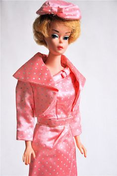 Blonde Barbie w/Bubble Cut.  I still have my Barbie like this, as well as all of the clothes my Nana made for her!!