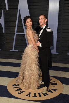 Mirai Nagasu (L) and Adam Ripon - 2018 VF Oscar Party