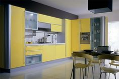 Yellow kitchen will be so much attractive for any home design whether big or small. It gives your room a bright color and more spacious. So, here are some yellow kitchen ideas for designing your kitchen room. Yellow Kitchen Cabinets, European Kitchen Cabinets, Kitchen Cabinet Colors, Kitchen Colors, Yellow Kitchens, Kitchen Ideas, Kitchen Decor, Kitchen Yellow, Kitchen Storage