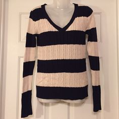 Navy and cream stripped cable knit sweater like new condition!! 60% cotton 40% polyester. very soft and ready for a new home. Arizona  Sweaters V-Necks
