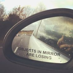 Objects in Mirror Are Losing Car Sticker. Watch objects disappear behind you as they 'lose' and you 'win' the driving race.  Decal will not fade or run when wet. Can be easily applied to any clean, smooth, flat surface.  Waterproof, self-adhesive, and removable.
