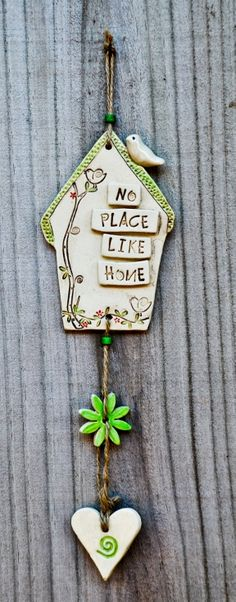 www.millerspottery.com.au  Australian Handmade Ceramics and Judaica -  ceramic wall-hanging house / mobile