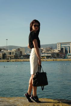 street style, Athens, Greece, black and white, leather, black leather, white pencil skirt, sneakers, sneakers outfit, sneakers and skirt, dark lips, minimal, chic, blogger, sea, port, breeze, breezy-easy, @thatgirlju