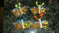 Nut free snack. Pretzel and skittles butterfly for birthday treat for school. Cheap,quick and easy! hot glue googly eyes and twist pipe cleaner around clothes pin