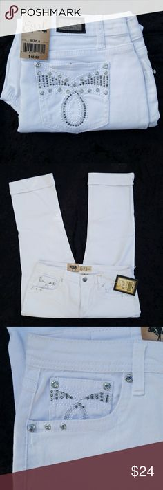 NWT   Earl Jeans White Capris with Rhinestones NWT  Classy white Jean capris with rhinestones. All rhinestones are still attached. In excellent condition and never worn.   Comes from a smoke-free home. Earl Jeans Jeans