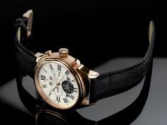 LOUIS XVI WATCH, stainless steel case in rose gold, white dial, roman numerals.