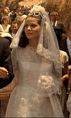 Apollonia - Dress, hair, veil, bouquet...I Love everything about this.