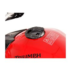 The SW-MOTECH QUICK-LOCK tankbag system enables a tankbag to be mounted or removed easily without the use of straps or magnets that may damage your mo…