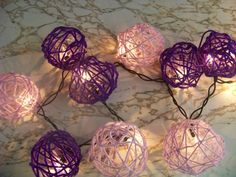 Same concept: yarn + balloon + diluted glue... but also +lights! This could be done in any color yarn, and used for various occasions.