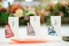 Origami And Kirigami, Paper Crafts Origami, Table Seating Cards, Paper Heart Garland, Oriental Wedding, Wedding Name Cards, Origami Wedding, Cherry Blossom Wedding, January Wedding