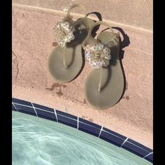 Feng Shoe SWAROVSKI sandals Glamorous sandals by Feng Shoe with original SWAROVSKI 💎 on the flower !!! Made in Italy from the best quality of PVC . Perfect for the beach, swimming pool or you can adjust it to your life style. Very comfortable worn for walking too !!!! Very good condition !!!!!! Feng Shoe Shoes Sandals