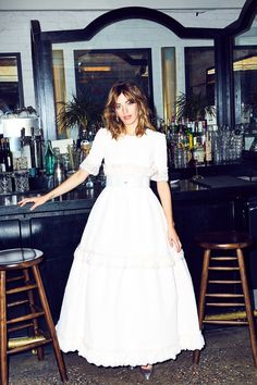Clara Mcgregor Wears Chanel Couture To The Movies: Below, Clara shows off our favorite looks from the house's most recent couture collection in her ideal setting: a gorgeous, old-school theater. ---- White Chanel dress and belt. | Coveteur.com