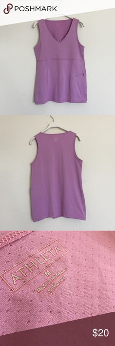 Athleta dusty pink perforated tank medium Excellent condition. Has a zippered key pocket on front. Size medium. Bundle to save 25%! Athleta Tops