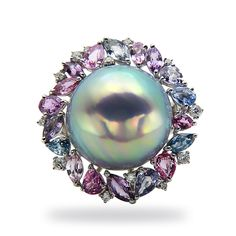 TARA Pearls Museum Collection 19X20mm Mabe pearl ring set in 18K white gold with diamonds and mixed sapphires.
