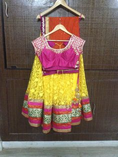 Let this outfit make your fashion statement..Stunning Lengha by Pareesa Boutique..Rich Yellow color Thread embroided net lengha fabric, with Pink raw silk gota patti blouse and orange Duppatta with velvet border.. #lehenga #choli #indian #shaadi #bridal #fashion #style #desi #designer #blouse #wedding #gorgeous #beautiful#Half Saree