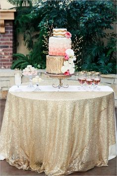 Metallic gold cake table, so stunning. Loving the cake too.