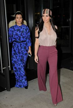Kim Kardashian High-Waisted Pants Kim Kardashian brought the '70s to life in a pair of high-waisted burgundy trousers. Kourtney Kardashian Print Dress Kourtney Kardashian donned a vibrant print maxi dress while out in NYC with Kim. Brand: Sunner