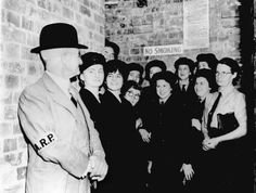Air raid warden and members of the Women's Auxiliary Australian  Air Force in one of Brisbane's air raid shelters during an alarm.