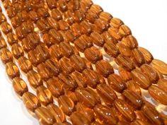 Cristal en forma de semilla lisa, color ambar tira 27 piezas, 1.2 cm, $35, Precio especial a mayoristas.