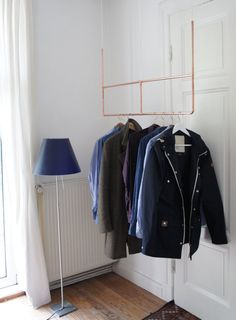 Elegant clothes hanger made from copper. Its fixed to the ceiling with three hooks. Everything you need is included. Copper is a wonderful material that ages beautifully. Over time it will get a patina which can be removed very easily, if you wish so. Copper is 100% recyclable without any loss of quality. The hanger shown here is around 1,1 meter wide. Smaller sizes are available also.