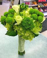 Mini green hydrangea, green button mums, green tea roses, green spider mums, green trick carnations and green hypericum berries