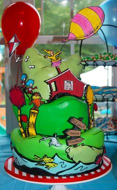 Amazing Dr. Seuss cake. I love the wonky mountains. this just absolutely captures Seuss's illustrations to a tee.