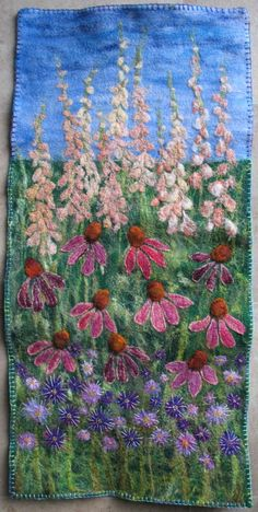 I ❤ embroidery . . . Flower border hanging- I am so glad that I needle felted the base of this wall hanging before going away skiing over Christmas. It gave me something to hand embroider while I had my injured knee propped up!! ~by Claire Cousins
