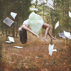 For so long she had waited, killing the time by reading tales of what she desired to be. Desperate was what they called her; eager, begging for her time to come. Ah, but at last, in the middle of her favorite story (she began to rise, she began to fly) she started her own, at last.