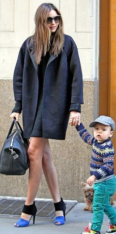 #Miranda Kerr The 29-year-old showed off her legs in a knitted black dress paired with a near-matching coat