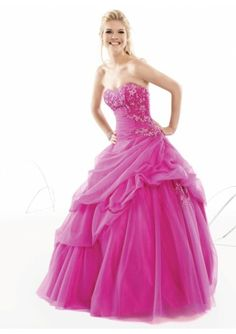 Pretty pink princess ball gown.    Lots of tulle, pickups and beading.  Prom perfect!