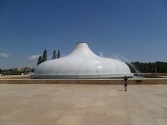 The Shrine of the Book, a wing of the Israel Museum near the Knesset (Israeli Parliament) in Jerusalem, houses the Dead Sea Scrolls—discovered 1947–56 in 11 caves in and around the Wadi Qumran. Two American architects designed the roof of the Shrine of the Book to make it look like one of the jars that contained the Scrolls. Two-thirds of the Shrine are underground because the designers wanted you to experience what it was like to walk into one of the  caves and discover these treasures.