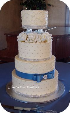 Elegant White and Cornflower Blue Wedding Cake with Silver Accents by Graceful Cake Creations, via Flickr