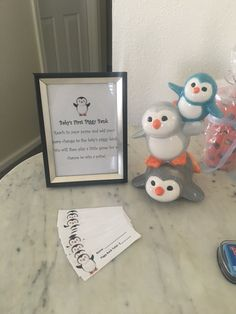 Penguin Baby Shower Game- Baby's first piggy bank.  Guest add their spare change to the piggy bank.