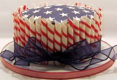 """July 4 2008 - Six layers of WASC with cherry sleeve filling and SMBC icing. """"Cigarellos†are fondant, top is blue candy clay with fondant stars. I used a calyx cutter for the stars. Fourth Of July Cakes, 4th Of July Celebration, July 4th, Army's Birthday, Birthday Cakes, Military Cake, American Cake, July Holidays, Summer Cakes"""
