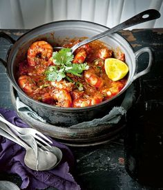 prawns with tomato and coriander A great starter for a romantic meal, they're sure to be wooed by these smoky prawns with tomato and coriander.A great starter for a romantic meal, they're sure to be wooed by these smoky prawns with tomato and coriander. Fish Recipes, Seafood Recipes, Indian Food Recipes, Cooking Recipes, Healthy Recipes, Ethnic Recipes, King Prawn Recipes, Goan Recipes, Cooking Fish