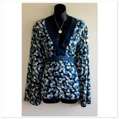 Beautiful Floral Print Blouse Pre-Owned floral pattern blouse, gently worn, no rips or tears! great condition, long sleeves, size XL,  100% silk, colors are Navy blue, yellow , green. Wash inside out, hang dry. New York & Company Tops Blouses