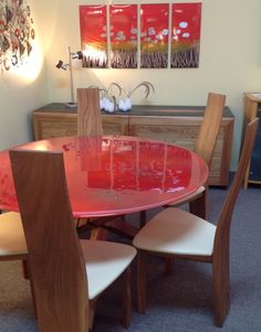 Poppy Red Glass Dining Table with Solid Elm Chairs, Available at Scanhome Furnishings in Green Bay.