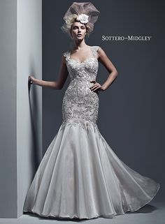 Decadent fit and flare wedding dress, with Swarovski crystal encrusted bodice and flowing organza skirt.... Kaya by Sottero and Midgley.