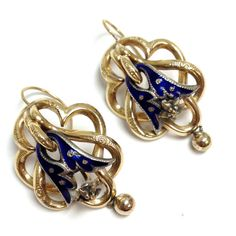 These absolutely stunning earrings are antique and easy to wear. They are made out of solid 14K yellow gold and have a blue enamel area made of