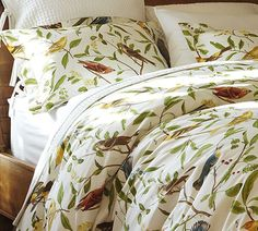 Pottery Barn white coverlet and bird bedding