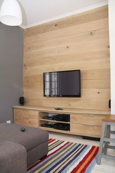 I really like the wood panels against the wall